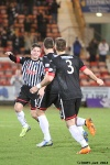 Pars v Arbroath 25th February 2014. Stephen Husband celebrates with Josh Falkingham and Danny Grainger.