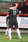 Pars v Arbroath 25th February 2014. Ross Forbes celebrates with Danny Grainger!
