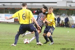 Pars v Arbroath 25th February 2014. Faissal El Bakhtaoui v Michael Travis (5) and Alex Keddie (6).