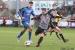 Pars v Stranraer 11th January 2014. Ryan Wallace v former Pars player Steven Bell.