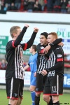 Pars v Stranraer 11th January 2014. Ryan Thomson celebrates with Faissal El Bakhtaoui.