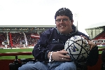 Nathan Davies aka Tartan Red with his signed DAFC football.