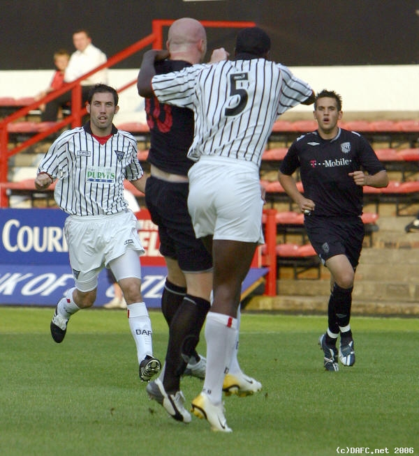 (c) www.DAFC.net Photographs can be requested from photos@dafc.net  Hartson returns to East End Park<br>and is well marked by Soulemayne Bamba  (WestBrom_25Jul2006_Bamba_Hartson.jpg)